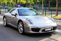 Porsche 911 Carrera S (type 991) ロジウムシルバー / 年式 2013 シフト 7速 ハンドル L 初度登録 平成24年12月 排気量 3,800cc 走行距離 18,000Km 車検期限 平成27年12月 ミッション PDK 修復歴 なし カラー(外装) プラチナシルバーメタリック カラー(内装) ヨッティングブルー  装備オプション 自動防眩ミラー エレクトリックコントロールシート スポーツステアリング 電動可倒式ドアミラー サーボトロニック スポーツクロノパッケージ パークアシスト(リア) PDLS スモーカーパッケージ カラークレストホイールセンターキャップ シートヒーター