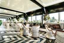 Sweetwater Rooftop Bar / Sweetwater Rooftop Bar, East Fremantle  Dramatic bohemian with touches of gold, Myaree Ceramics supplied the tiles throughout, including a striking chevron feature floor of Burlington Ivory and Grey.