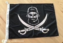"""TBOC """"Bearded SEAL"""" Flags / What is more capable than a Navy SEAL? You are right! A BEARDED Navy SEAL! We have taken the Calico Jack flag and reinvented it to make it even more badass. Beside that, this patch is inspired by the usage of the original Calico Jack by SEAL Team 6. In addition to that it is an ode to all bearded buccaneers and freebooters out there. May your beard protect you from the elements and stormy seas while making the waves in an ocean of the beardless. Arrr arrrr."""