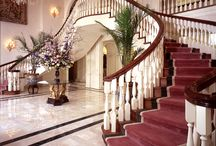 Classical Staircases / Arcways CLASSICAL curved stairways follow a broad spectrum of historical faithful influences. Our freestanding and wall supported stairways can be completely customized with custom shaped (not bent) handrail profiles; helical descending volutes with barrel bases; carved skirt brackets; stone treads & risers; hand carved balusters from Spain; hammer forged custom iron railings and more.