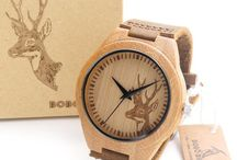 Watch in a wooden case.