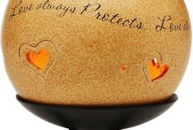 """Comfort Candles by Pavilion / Comfort Candles are a unique line of attractive candle holders with inspirational sayings. The packaging is a beautiful gift box; it's a wonderful """"Gift to Go""""! These versatile candles hold a tealight and include a fashionable copper lid. Whether the candle is glowing or the copper lid is on, these items are a true decorative home accessory. The warm coloration and finish on the candles will be perfect your home."""