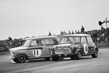 Former teammates Steve Neal and John Rhodes achieved fame together in their Classic Mini racers. Silverstone 1969 found them fighting for rank. - photo from miniusa