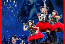 """BABYMETAL / BABYMETAL is a Japanese metal idol band. Their line-up consists of Suzuka Nakamoto as """"Su-metal"""", Yui Mizuno as """"Yuimetal"""", and Moa Kikuchi as """"Moametal"""". The concept of the group is a fusion of the heavy metal and Japanese idol genres.  Their vocals are backed by heavy metal instrumentation played by the Kami Band."""