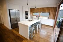 Timber Veneer & white cabinetry in modern Kitchens