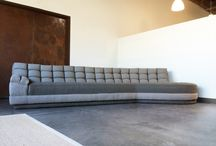 couch lounger made by Carbon Footprint / The couch lounger. A reuse project from inception featuring renovated springs, modern padding, refreshed canvas netting, hand-cut, sewn, and tufted two-tone grey fabric, all lovingly renewed in-house by hand.