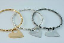 LOVE 2014 / New elastic bracelets with balls in silver gold, silver, bronzed with a Time Machine Heart. - Nuovi bracciali elastici con sfere in argento dorate, argentate, brunite con cuore a Time Machine.