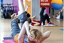 Fitness aux Cercles de la Forme / Le Fitness, terme anglo-saxon des années 1980 est un concept d'entrainement dont l'objectif est d'améliorer la condition physique par la pratique d'activités physiques en salle d'entrainement, qui peut se classifier de la façon suivante :  Travail Cardio :  •Activité d'endurance sur appareils (Tapis, vélos,...) •Activité de cours chorégraphiés (L.I.A, step...)  Travail de Renforcement Musculaire:  •Activité de musculation et renforcement à base de poids légers.