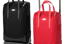 Laptop bag on wheels / Carrying your laptop around in a backpack or in your shoulder isn't very ergonomic. A laptop bag on wheels fixes that problem.