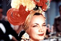 Carmen Miranda, (she started the fashion in shoes, platform and high heels. / Dancer, actress, singer,   A little bomb shell when she performed.  A. Lot of pazzaz...