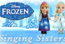 "Disney Frozen Singing Sisters | Anna and Elsa Doll Videos / http://www.blurootoys.com  Disney's Frozen Princesses, Anna and Elsa sing in both English and Spanish. Watch our Anna and Elsa Doll videos to see the Frozen singing doll set in action. They light up and have different bilingual phrases. Elsa sings, ""Let It Go,"" and Anna sings, ""Do You Want to Build a Snowman?"""