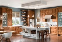 Rustic Luxe / This Beverly knotty alder kitchen finished in Chestnut Ebony Glaze adds a contemporary finishing touch to the beauty of traditional details. Floating shelves and an open island create a light, airy feeling, balanced by strong style statements from the warm Chestnut Ebony Glaze finish and Catania aluminum doors with frosted glass. / by InnerMost Cabinets