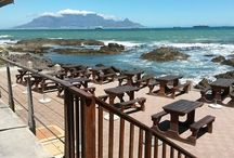 On the Rocks / On the Rocks, the most exquisite and internationally acclaimed Restaurant in Bloubergstrand, is situated on the waters edge and boasts breathtaking views of Table Mountain, Robben Island and Cape Town.