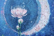 The Lotus Story / The lotus flower grows in muddy water and rises above the surface to bloom with remarkable beauty. At night the flower closes and sinks underwater, at dawn it rises and opens again. It symbolizes many things, most importantly Re-birth.