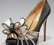 Shoe Fetish / Shoes are a girl's best friend!! You can never have too many! / by Janine Schmidt