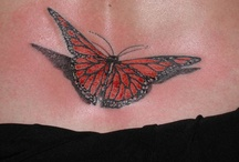 cool tattoos / by Gina Harrison