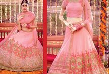 Women's lehangas - Online Shopping India / Designer Lehenga Choli soft Tons Of Pink on Tonal Thread, Mofits Zari And Sequin With Underlying Golden finish innovative Work.  www.onlineshoppingindia.com