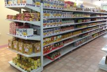 Gondola Shelving / A choice of mesh or pegboard backing sheets, front/side fence shelf rails, wire basket dividers, peg hooks, ticket strips, wire baskets.