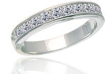 Channel Set Wedding Bands From Diamonds Rock / In a Channel Set, the diamonds are secured between two strands of precious metal (typically gold or platinum). Each stone is securely set in the tiny groves on either side of the channel. Typically, princess cut diamonds or round brilliant cut diamonds will be set in the mountings. Emerald cut diamonds are a great alternative because these stones sit slush against one another and have a bright, big flash. This style bad is a very classic, traditional style.