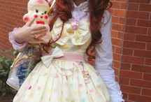 Lolita / Lolita fashion is a fashion subculture originating in Japan that is based on Victorian-era clothing. The Lolita look began primarily as one of modesty. The original silhouette is of a knee length skirt or dress with a 'cupcake' shape assisted by petticoats. Blouses, knee high socks or stockings and headdresses are also worn. - Lolita wiki / by Nicole Robbins