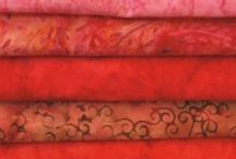 """Sew Simple Batiks / Our Stamped Batiks are all the rage - and we offer 250 different ones. With our Polo batiks, also known as """"Smoke"""" batiks, are ideal for mixing and matching. We have 112 colours in the range - you'll find the one you're looking for, guaranteed."""