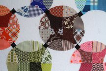 flowering snowball quilts / by Ina