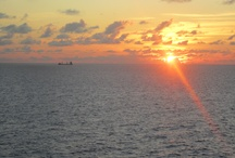 Cruise Ship Sunsets / Have you ever watched a sunset from aboard a cruise ship while at sea?  There's nothing like seeing it in person, but until you can, this board is dedicated to you.  #atsea #sunsets #cruiseships #cruisevacations