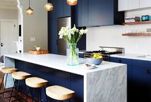 ID 30 Kitchen / Navy kitchen with asthetic white marble and gold detailing.