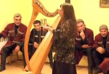 Mandragore (Mandrake) harpist singer playing and singing in Georgia with Vakho Pilpani