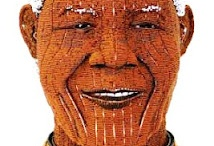 Madiba's Smile / From clocks to surf boards, he embraces the funkiness and spirit in which it was intended - tribute to a legend African style.