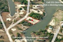 Expansive Canal Lot for Sale in Outer Banks NC | 905 Plover Ct / Escape The Pavement and get-a-way to your own little piece of paradise. This canal lot in Carova Beach has 100 feet of water frontage and is already bulkheaded with a 4 bedroom septic system already installed. The lot has already been cleared and is very close to the entrance to the sound for easy access by boat and wonderful views from you future beach home. Buy this lot for sale now by calling me, Jean-Paul Peron, at 252-564-9390.