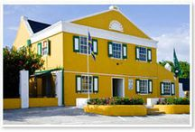 Landhuizen of Curacao / In the 18th and 19th century Landhuizen in Curacao were being used as mansions where the wealthy lived and had slaves to farm their plantations. Nowadays they are used as museums, offices or even tourist attractions, like Landhuis Chobolobo.