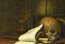 Symboles évoquant la mort dans les vanités / Mouche qui précède le ver de la porriture et les insectes d'une manière générale. Les pétales fanés, les fruits pourris, les coupelles ébréchees, le crâne, la bougie consumée...