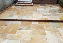 Desert Sandstone Patio Installation / We were called in to update a rear garden at this modern terraced family home in Oxford.  The garden was tired, cluttered and provided little room for entertaining.  Pergolas, a large shed, planting and paving were all working against each other for space.  The new owners realised that a low maintenance redesign was required and contacted AWBS to turn their ideas for a smart new sandstone paved garden into a reality. #sandstone #paved #garden
