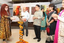 """Dhananjay Mukherjee curates solo art exhibition to venerate 'Vandevta' / Eminent artist Dhananjay Mukherjee curated a solo art exhibition of his paintings titled """"Vandevta"""" (God of the Rain Forest) at the ICCR, New Delhi. The exhibition was formally inaugurated by world renowned Beauty and Wellness Ambassador Padam Shri awardee Shahnaz Husain. Coinciding with the World Environment Day Celebrations, the exhibition was organized to spread awareness about protecting the 'greens' and the environment."""