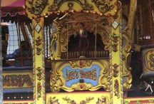 Fairground organs / Nineteenth century fairgrounds were entertained by music from elaborately designed mechanisms. They were carved and painted and played popular songs of the day. These bellows and pipe organs have been restored by volunteer craftsmen and now tour exhibition grounds around the UK