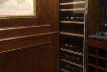 Wine Room / Wine room with oak veneered wall panels bar unit