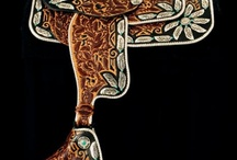 Leather / Leather has long been used in functional art, ranging from furniture to picture frames.  This category displays hand tooling and leather manipulation of exquisite quality and craftsmanship.