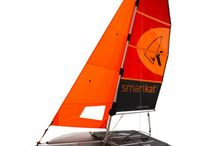 "Smartkat Catamarans / We are proud of being an official partner of Smartkat- the lightest inflatable performance sailing catamarans in the market: - Innovative/patented centerboard design  - Unique 6-Beaufort Wind Force Certification  - Official DSV approval for regattas  - Designed for single-handed transport/setup/sailing FREE ""READY TO SAIL PACKAGE"": - Manual hand pump  - Replacement shackles  - Manometer - Hull repair kit - Two waterproof transport bags  Designed in Germany, made in Austria"