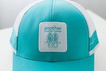 "Mother Runner Trucker Hats / Run Like a Mother.... rhymes with ""trucker"" ;-) Thus, we just HAVE to offer technical Another Mother Runner trucker hats (made by BoCo Gear). Our collection even includes limited-edition hats for Chicago Marathon and New York City Marathon. So sassy and hip!"