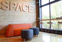SPACE Powered by Custer / SPACE Powered by Custer is a showroom & co-working facility located in Traverse City, MI. This urban interior is made to host big ideas and a community of creative minds. Furniture supports mobile workers who need a place to sit down, plug in, & get to work.