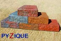 """Pyzique / St. Vrain Block in Dacono, Co.  Is a proud producer of the pyzique block system which can be used for fire pits, planters, retaining/free-standing walls, and many other creative uses.  They are a trapezoidal block that has a rough face on front and back, its dimensions are (11""""w front x 10"""" deep x 7""""w back x 4"""" h).   Give us a call at 303-833-4144 for more information and pricing."""