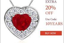 Heart-Shaped-Ruby-And-Diamond-Halo-Pendant