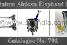 African Aluminium Tableware Range / Cataloue No. 793 contains African Elephant Aluminium Collection.The Range contains Jug,Vase,Bowl,Tray,Wine Bucket,Salad Servers,Ice Bucket,Nut Bowl & many more. All our aluminium products are foodsafe .All our Aluminium products are handmade & buff high quality polished.The Product range can be customised as per our client requirement with Enamel finish,brass,nickel,copper plated.