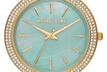 This sparkly gold watch with a mint dial is sure to turn heads.