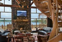 Log Homes with Spiral Staircases / Honest Abe Log homes can add beauty to your log home by using a metal and wooden spiral staircase.  Spiral staircases are functional art that add warmth to any room.