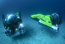 Exploring the Oceans with Submarines / SEAmagine personal submarines and private submersibles seen diving underwater at various locations exploring the ocean depths.