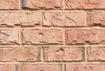 Magnolia  Triangle Brick Company / With light red to coral tones and a tumble washed texture, the Magnolia brick will give your project a fresh look. Just like a blossoming flower or an ocean sunset, this brick style showcases shades of cream and orange that vary from brick to brick, offering a unique exterior to your project. The Magnolia brick is classified under Triangle Brick Company's Premium tier products and creates a statement with lighter, intriguing tones.