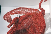 Into the dragons den. / Red in tooth and claw Knitted recycled plastic coated wire body pieces.