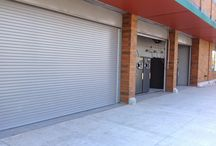 Rolling Doors To Secure / Use our rolling doors to secure recycling areas. This is an installation with exterior fascias.